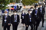 Members of the South Korean band BTS, from left, J-Hope, Jung Kook, Suga, Jimin, partially obscured, Jin and RM arrive to security check-in at United Nations headquarters, Monday, Sept. 20, 2021, during the 76th Session of the U.N. General Assembly in New York. In his General Assembly opening address on Tuesday, U.N. Secretary-General Antonio Guterres practically scolded world leaders for disappointing young people with a perceived inaction on climate change, inequalities and the lack of educational opportunities, among other issues important to young people. (AP Photo/John Minchillo, Pool)