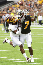 Central Michigan's Donte Kent, left, breaks up a pass intended for Missouri's Dominic Lovett, right, during the first half of an NCAA college football game Saturday, Sept. 4, 2021, in Columbia, Mo. (AP Photo/L.G. Patterson)