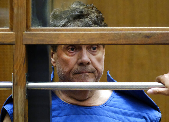 FILE - In this July 1, 2019, file photo, Dr. George Tyndall, 72, listens during his arraignment at Los Angeles Superior court in Los Angeles. The U.S. Department of Education said Thursday, Feb. 27, 2020 it found systemic failures in the University of Southern California's handling of allegations of sexual abuse by a longtime campus gynecologist and ordered the school to overhaul its procedures for preventing sex discrimination, conduct a formal review of how employees responded and allow compliance monitoring for three years. (AP Photo/Richard Vogel, File)