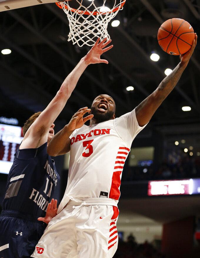 Dayton guard Trey Landers (3) puts up a shot against North Florida guard Garrett Sams (11) during the first half of an NCAA college basketball game, Monday Dec. 30, 2019, in Dayton. (AP Photo/Gary Landers)