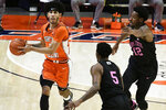 Illinois guard Andre Curbelo (5) looks to pass as he is pressured by Penn State guard Jamari Wheeler (5) and guard Izaiah Brockington (12) during the second half of an NCAA college basketball game Tuesday, Jan. 19, 2021, in Champaign, Ill. (AP Photo/Holly Hart)