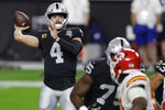Las Vegas Raiders quarterback Derek Carr (4) throws against the Kansas City Chiefs during the first half of an NFL football game, Sunday, Nov. 22, 2020, in Las Vegas. (AP Photo/Isaac Brekken)