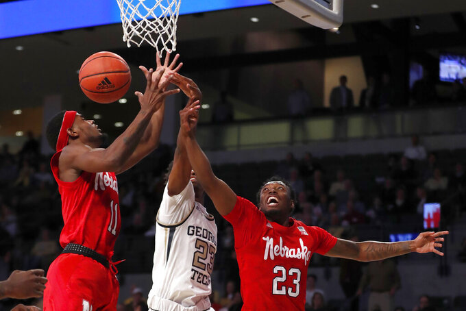 Nebraska guards Dachon Burke Jr. (11) and Jervay Green (23) battle Georgia Tech guard Shembari Phillips (2) for a rebound in the first half of an NCAA college basketball game Wednesday, Dec. 4, 2019, in Atlanta. (AP Photo/John Bazemore)