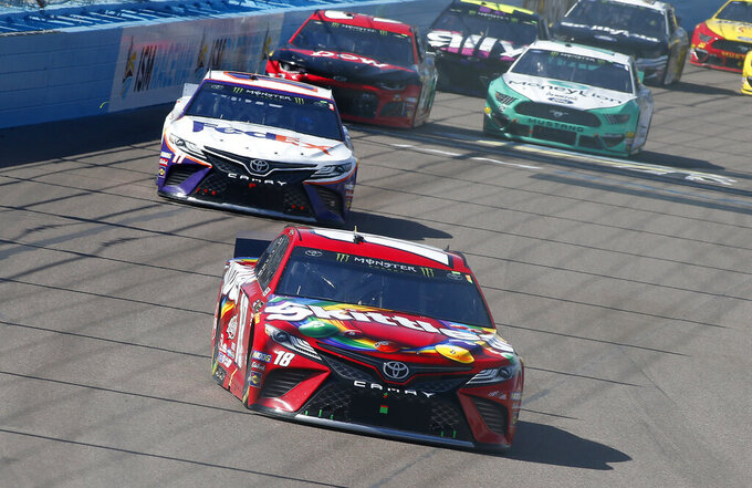 Kyle Busch (18) leads the field during the NASCAR Cup Series auto race at ISM Raceway, Sunday, March 10, 2019, in Avondale, Ariz. (AP Photo/Ralph Freso)