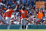 Baltimore Orioles' Trey Mancini (16) celebrate with Hanser Alberto (57) after scoring on a single by Rio Ruiz during the sixth inning of a baseball game against the Boston Red Sox in Boston, Saturday, April 13, 2019. (AP Photo/Michael Dwyer)