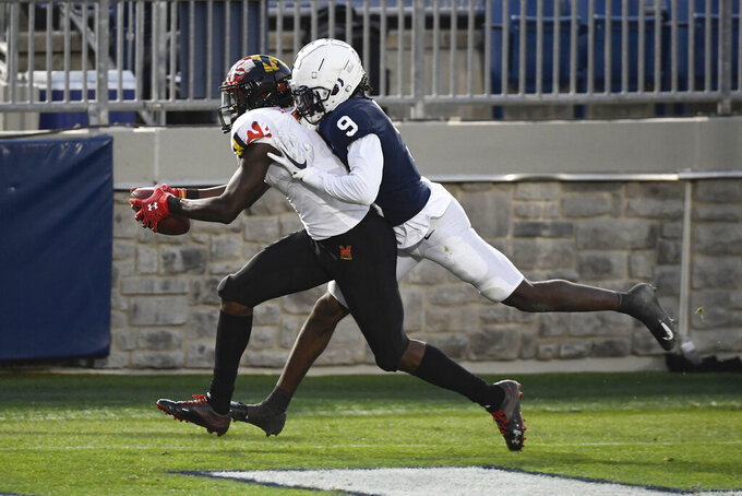 Maryland wide receiver Dontay Demus Jr. (7) catches a second-quarter touchdown pass in front of Penn State cornerback Joey Porter Jr. (9) during an NCAA college football game in State College, Pa., Saturday, Nov. 7, 2020. (AP Photo/Barry Reeger)