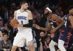 New York Knicks' Mitchell Robinson (26) defends Orlando Magic's Nikola Vucevic (9) during the second half of an NBA basketball game Tuesday, Feb. 26, 2019, in New York. The Knicks won 108-103. (AP Photo/Frank Franklin II)