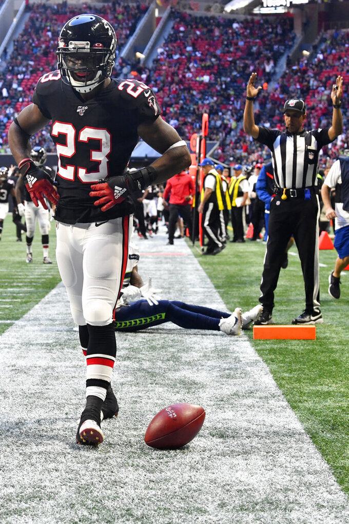 Atlanta Falcons running back Brian Hill (23) celebrates his touchdown against the Seattle Seahawks during the second half of an NFL football game, Sunday, Oct. 27, 2019, in Atlanta. (AP Photo/John Amis)