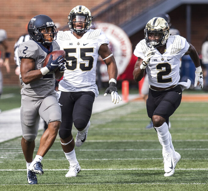 Illinois running back Reggie Corbin (2) is pursued by Purdue's Derrick Barnes (55) and Kenneth Major (2) after making a catch in the first half of an NCAA college football game Saturday, Oct. 13, 2018, in Champaign, Ill. (AP Photo/Holly Hart)