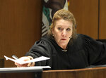 Judge Teresa Sullivan presides at the arraignment for Ivan Hernandez, facing charges of killing a University of Southern California music student, in a Los Angeles courtroom, Tuesday, July 2, 2019. The Los Angeles County District Attorney's Office says Hernandez was charged with one count of murder during the course of an attempted robbery and murder while being an active participant in a criminal street gang. Victor McElhaney was fatally shot in March about a mile from campus. He was the son of Oakland City Councilwoman Lynette Gibson McElhaney. (AP Photo/Reed Saxon)