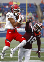 Cincinnati wide receiver Rashad Medaris, left, catches a pass in front of Virginia Tech defensive back Tyree Rodgers in the first half of the Military Bowl NCAA college football game, Monday, Dec. 31, 2018, in Annapolis, Md. (AP Photo/Patrick Semansky)