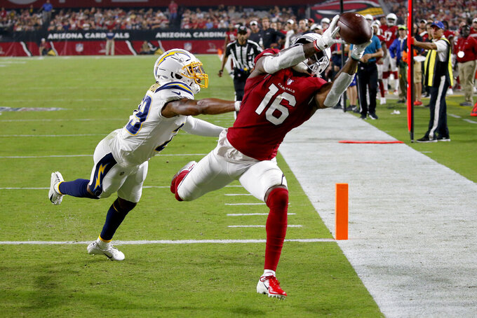 Arizona Cardinals wide receiver Damiere Byrd (14) pulls in a touchdown pass as Los Angeles Chargers defensive back Jeff Richards (29) defends during the first half of an NFL preseason football game, Thursday, Aug. 8, 2019, in Glendale, Ariz. (AP Photo/Ross D. Franklin)