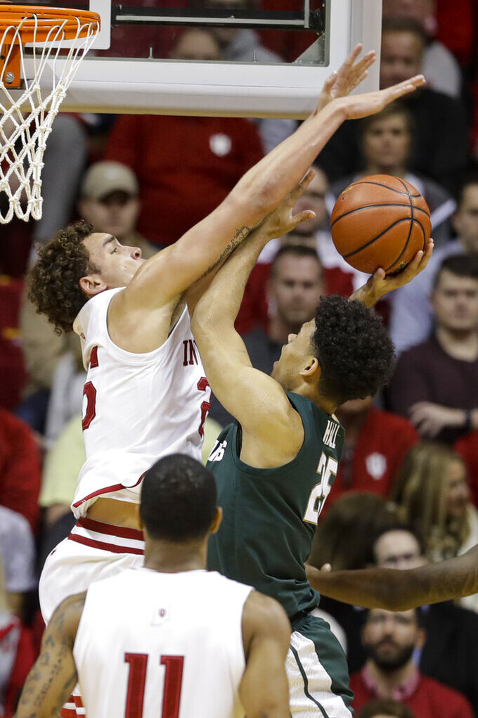 Indiana forward Race Thompson (25) blocks the shot of Michigan State forward Malik Hall (25) in the first half of an NCAA college basketball game in Bloomington, Ind., Thursday, Jan. 23, 2020. (AP Photo/Darron Cummings)