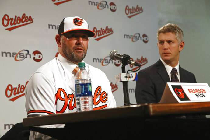 FILE - In this Dec. 17, 2018, file photo,  Baltimore Orioles manager Brandon Hyde, left, speaks alongside executive vice president and general manager Mike Elias during a baseball news conference in Baltimore. Elias and Hyde cautioned fans on Saturday, Jan. 26, 2019, that there will be no quick fix for a franchise that underwent a complete overhaul during and after the worst season in Orioles history. (AP Photo/Patrick Semansky, File)