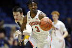 Arizona guard Dylan Smith, right, steals the ball from Pennsylvania forward AJ Brodeur, left, during the first half of an NCAA college basketball game at the Wooden Legacy tournament in Anaheim, Calif., Friday, Nov. 29, 2019. (AP Photo/Alex Gallardo)