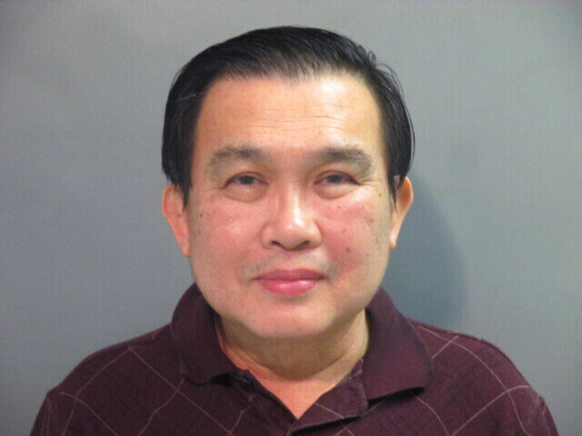 A photo provided by the Washington County (Ark.) Detention Center shows Simon S. Ang, 63. The University of Arkansas has suspended Ang, an electrical engineering professor, without pay after he was arrested on an allegation that he failed to disclose that he had close ties with the Chinese government and Chinese businesses. (Washington County Detention Center via AP)