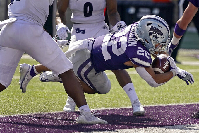 Kansas State running back Deuce Vaughn (22) dives into the end zone to score a touchdown during the second half of an NCAA college football game against Nevada Saturday, Sept. 18, 2021, in Manhattan, Kan. (AP Photo/Charlie Riedel)