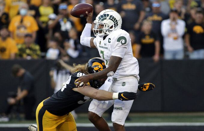 Colorado State quarterback Todd Centeio (7) is tackled by Iowa defensive lineman Chris Reames (98) during the second half of an NCAA college football game, Saturday, Sept. 25, 2021, in Iowa City, Iowa. (AP Photo/Ron Johnson)