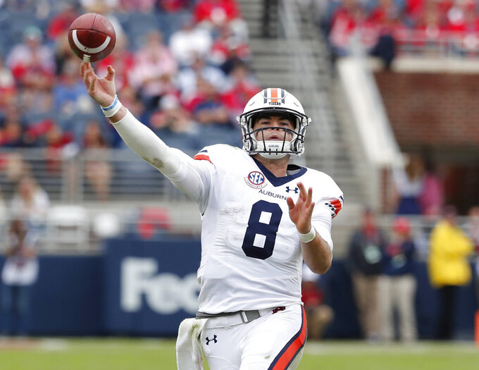 Auburn quarterback Jarrett Stidham (8) passes against Mississippi during the second half of an NCAA college football game on Saturday, Oct. 20, 2018, in Oxford, Miss. Auburn won 31-16. (AP Photo/Rogelio V. Solis)
