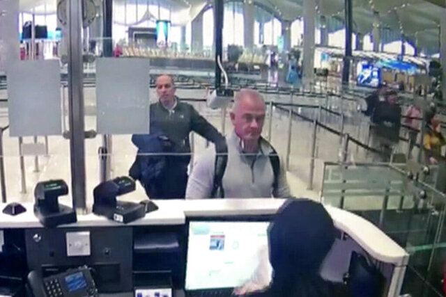 FILE—This Dec. 30, 2019 image from security camera video shows Michael L. Taylor, center, and George-Antoine Zayek at passport control at Istanbul Airport in Turkey. A federal judge has ruled that the Taylor and his son, accused of smuggling former Nissan Motor Co. Chairman Carlos Ghosn out of Japan while he was awaiting trial on financial misconduct charges, can be extradited. (DHA via AP)