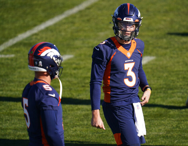 Denver Broncos quarterback Drew Lock, right, confers with quarterback Riley Neal during NFL football practice Wednesday, Nov. 25, 2020, in Englewood, Colo. (AP Photo/David Zalubowski)