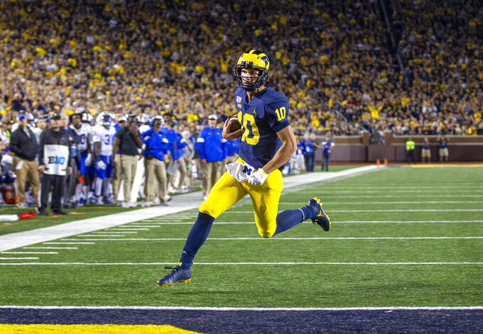 Michigan quarterback Dylan McCaffrey rushes for a touchdown during the third quarter of an NCAA football game against Middle Tennessee in Ann Arbor, Mich., Saturday, Aug. 31, 2019. Michigan won 40-21. (AP Photo/Tony Ding)