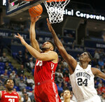 Wisconsin's Charles Thomas (15) makes a basket in front of Penn State's Mike Watkins (24) during first half action of an NCAA college basketball game in State College, Pa. Sunday, Jan. 6, 2019. (AP Photo/Chris Knight)