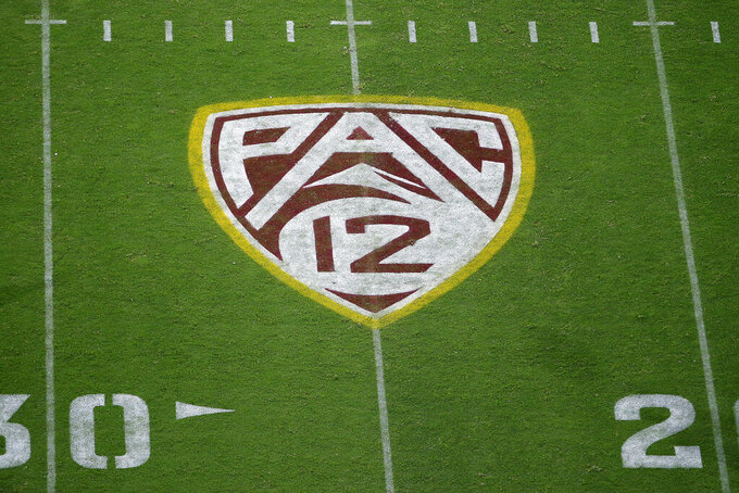 FILE - In this Aug. 29, 2019, file photo, the Pac-12 logo is displayed on the field at Sun Devil Stadium during an NCAA college football game between Arizona State and Kent State in Tempe, Ariz. As the wealthiest conferences  like the Pac-12 lay out plans they hope will protect athletes from contracting and spreading COVID-19, most of the schools in the second-tier of Division I football have given up on trying to play in the fall. (AP Photo/Ralph Freso, File)