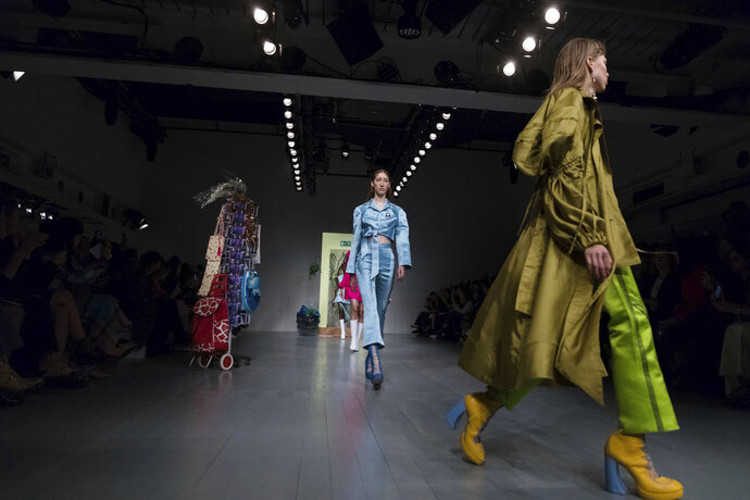 Models wear creations by designer Richard Malone during the Spring/Summer 2019 runway show at London Fashion Week in London, Friday, Sept. 14, 2018. (Photo by Vianney Le Caer/Invision/AP)