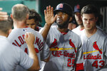 St. Louis Cardinals' Dexter Fowler celebrates in the dugout after scoring during the sixth inning of the team's baseball game against the Cincinnati Reds, Thursday, July 18, 2019, in Cincinnati. (AP Photo/John Minchillo)