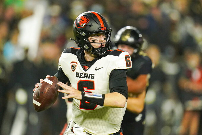 Oregon State quarterback Sam Noyer (6) throws against Purdue during the first half of an NCAA college football game in West Lafayette, Ind., Saturday, Sept. 4, 2021. (AP Photo/Michael Conroy)