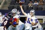 Houston Texans defensive end DeMarcus Walker (44) pressures as Dallas Cowboys quarterback Cooper Rush (10) throws a pass in the first half of a preseason NFL football game in Arlington, Texas, Saturday, Aug. 21, 2021. (AP Photo/Michael Ainsworth)