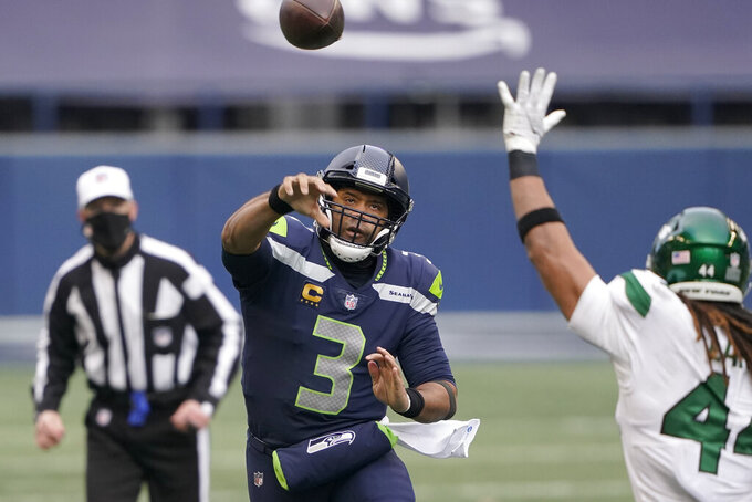 Seattle Seahawks quarterback Russell Wilson throws against the New York Jets during the first half of an NFL football game, Sunday, Dec. 13, 2020, in Seattle. (AP Photo/Ted S. Warren)