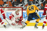 Detroit Red Wings goaltender Thomas Greiss (29) stops a Nashville Predators defenseman Roman Josi (59) shot in overtime during an NHL hockey game Tuesday, April 6, 2021, in Detroit. (AP Photo/Paul Sancya)