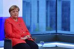 German Chancellor Angela Merkel, left, ahead of a televised interview at the hauptstadtstudio (Capital city studio) of public broadcaster ARD in Berlin, Thursday June 4, 2020. (John MacDougall/Pool via AP)