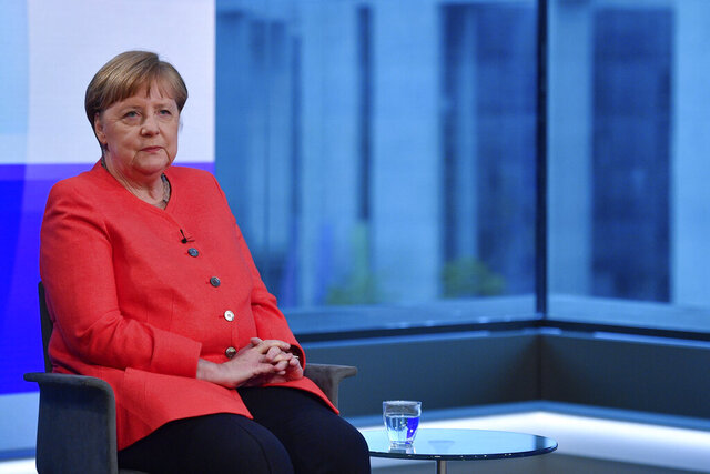 German Chancellor Angela Merkel, left, ahead of a televised interview at the hauptstadtstudio (Capital city studio) of public broadcaster ARD in Berlin, Thursday June 4, 2020. (John MacDougall/Pool via AP)