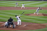 Seattle Mariners' Kyle Seager (15) singles to drive in a pair of runs, as Oakland Athletics starter Mike Fiers follows through on his pitch during the third inning of a baseball game Saturday, Aug. 1, 2020, in Seattle. (AP Photo/Elaine Thompson)