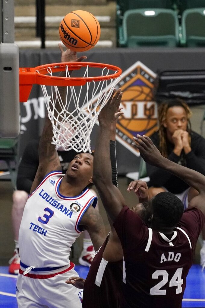 Louisiana Tech guard Amorie Archibald (3) goes up for a shot as Mississippi State forward Abdul Ado (24) and Iverson Molinar, right rear, defend in the second half of an NCAA college basketball game in the semifinals of the NIT, Saturday, March 27, 2021, in Frisco, Texas. (AP Photo/Tony Gutierrez)