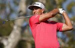 Adam Scott, of Australia, tees off on the 16th hole during the final round of the Genesis Invitational golf tournament at Riviera Country Club, Sunday, Feb. 16, 2020, in the Pacific Palisades area of Los Angeles. (AP Photo/Ryan Kang)