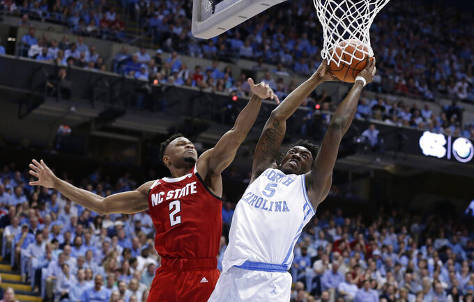 North Carolina's Nassir Little (5) drives to the basket while North Carolina State's Torin Dorn (2) defends during the first half of an NCAA college basketball game in Chapel Hill, N.C., Tuesday, Feb. 5, 2019. (AP Photo/Gerry Broome)