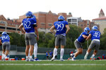 Kansas players run drills during NCAA college football practice, Thursday morning, Aug. 19, 2021, at the University of Kansas in Lawrence, Kan. (Evert Nelson/The Topeka Capital-Journal via AP)