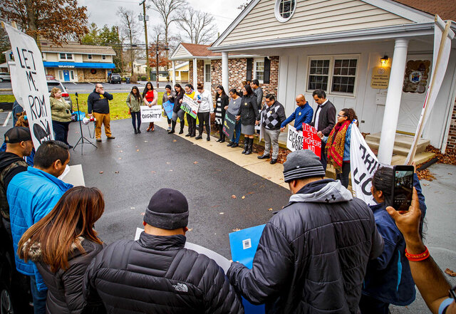 FILE - This Tuesday, Dec. 10, 2019 photo shows a rally with demonstrators calling for driver's license for immigrants, outside the the offices of New Jersey Assemblyman Vince Mazzeo and Assemblyman John Armato, in Northfield, N.J. New Jersey lawmakers are set to vote on legislation Monday, Dec. 16, 2019 to permit immigrants who cannot prove they're in the country legally to obtain drivers licenses. (Craig Matthews/The Press of Atlantic City via AP, File)