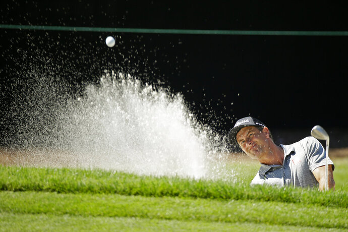 Adam Scott, of Australia, follows his shot out of a bunker onto the seventh green of the Silverado Resort North Course during the first round of the Safeway Open PGA golf tournament Thursday, Sept. 26, 2019, in Napa, Calif. (AP Photo/Eric Risberg)
