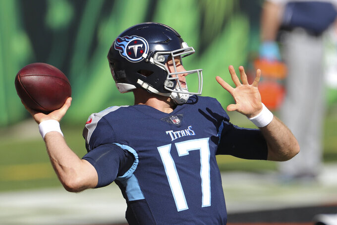 Tennessee Titans quarterback Ryan Tannehill (17) throws before an NFL football game against the Cincinnati Bengals, Sunday, Nov. 1, 2020, in Cincinnati. (AP Photo/Jay LaPrete)