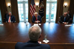 House Minority Leader Kevin McCarthy of Calif., left, and Chevron CEO Mike Wirth, right, listen to President Donald Trump speak during a meeting with energy sector business leaders in the Cabinet Room of the White House, Friday, April 3, 2020, in Washington. (AP Photo/Evan Vucci)
