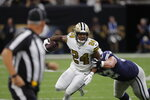 New Orleans Saints strong safety Vonn Bell (24) tries to return a fumble recovery against Dallas Cowboys offensive guard Connor Williams in the first half of an NFL football game in New Orleans, Sunday, Sept. 29, 2019. (AP Photo/Bill Feig)