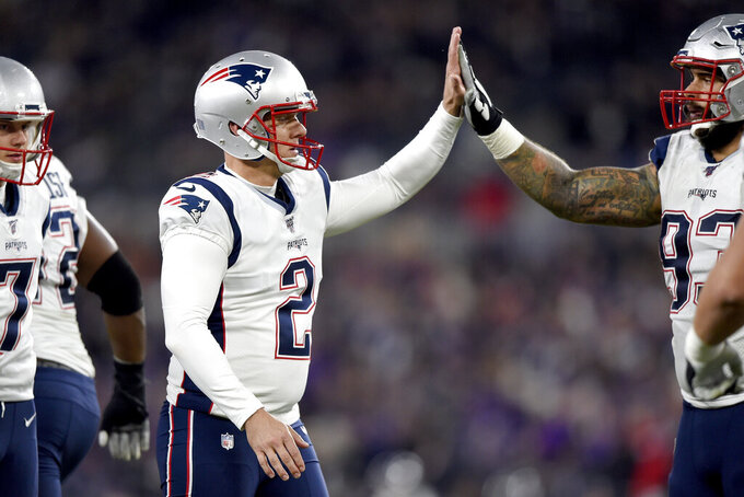 New England Patriots place kicker Nick Folk (2) celebrates his field goal against the Baltimore Ravens with defensive end Lawrence Guy, right, during the first half of an NFL football game, Sunday, Nov. 3, 2019, in Baltimore. (AP Photo/Gail Burton)