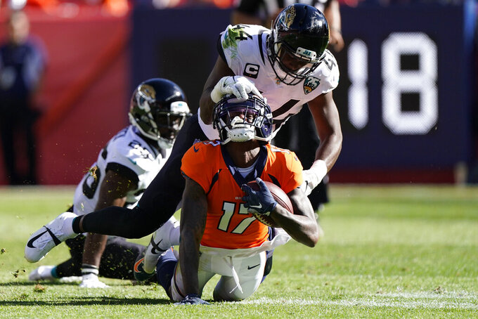 Jacksonville Jaguars middle linebacker Myles Jack, above, hauls on the facemark of Denver Broncos wide receiver DaeSean Hamilton, below, as he brings him down during the first half of an NFL football game Sunday, Sept. 29, 2019, in Denver. (AP Photo/Jack Dempsey)