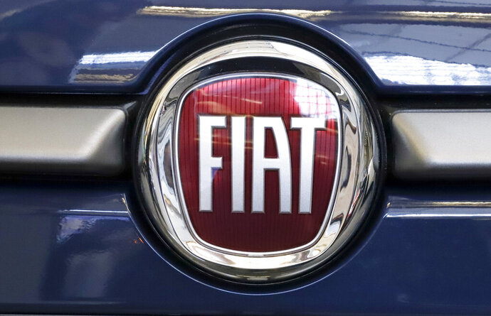 FILE - In this Feb. 14, 2019, file photo, this is the Fiat logo is mounted on a 2019 500 L on display at the 2019 Pittsburgh International Auto Show in Pittsburgh. Fiat Chrysler is proposing a merger with French carmaker Renault aimed at saving billions of dollars for both companies. (AP Photo/Gene J. Puskar, File)
