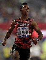 Japan's Abdul Hakim Sani Brown races in a men's 4x100 meter relay semifinal at the World Athletics Championships in Doha, Qatar, Friday, Oct. 4, 2019. (AP Photo/Petr David Josek)